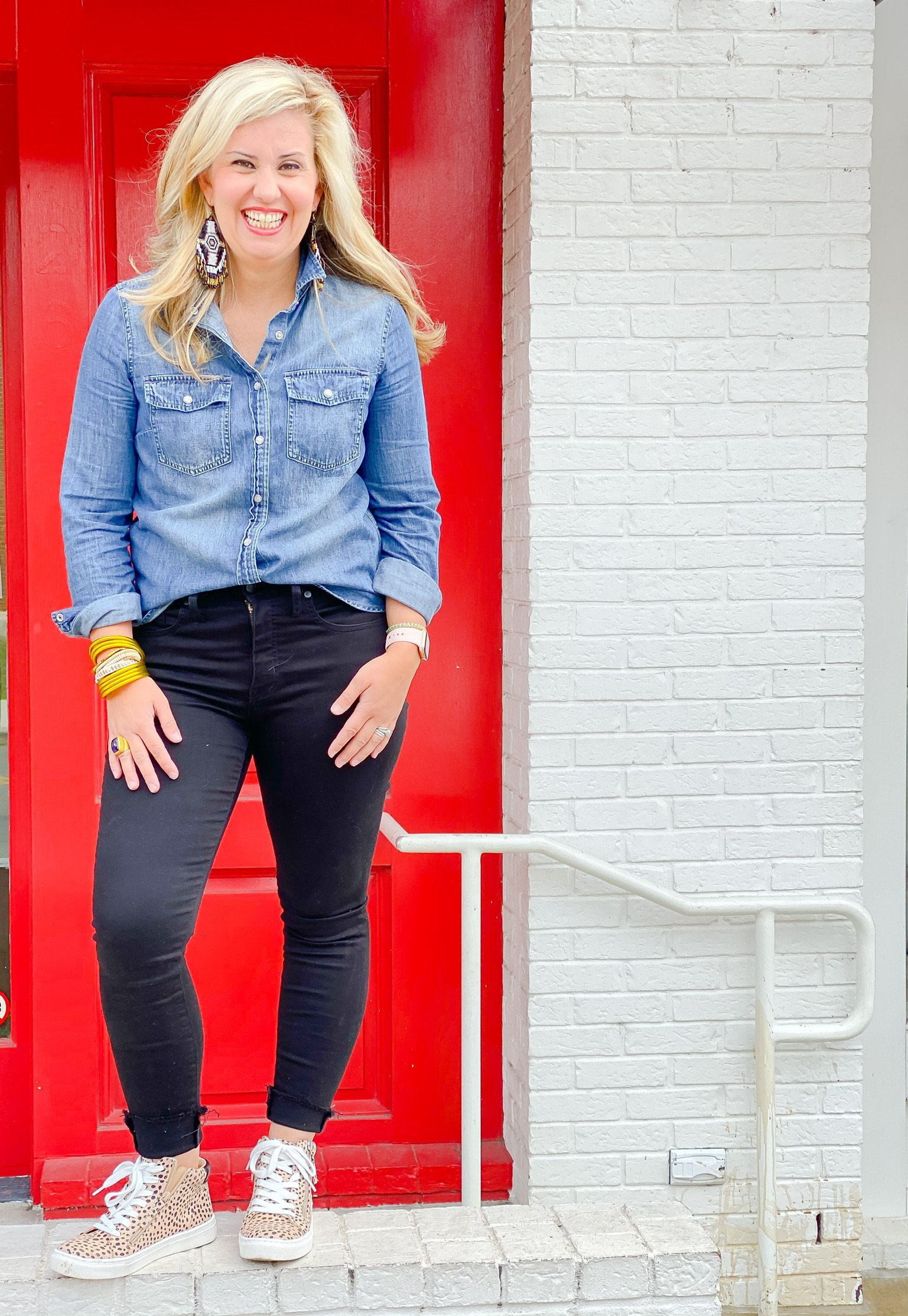 denim top tucked with black jean