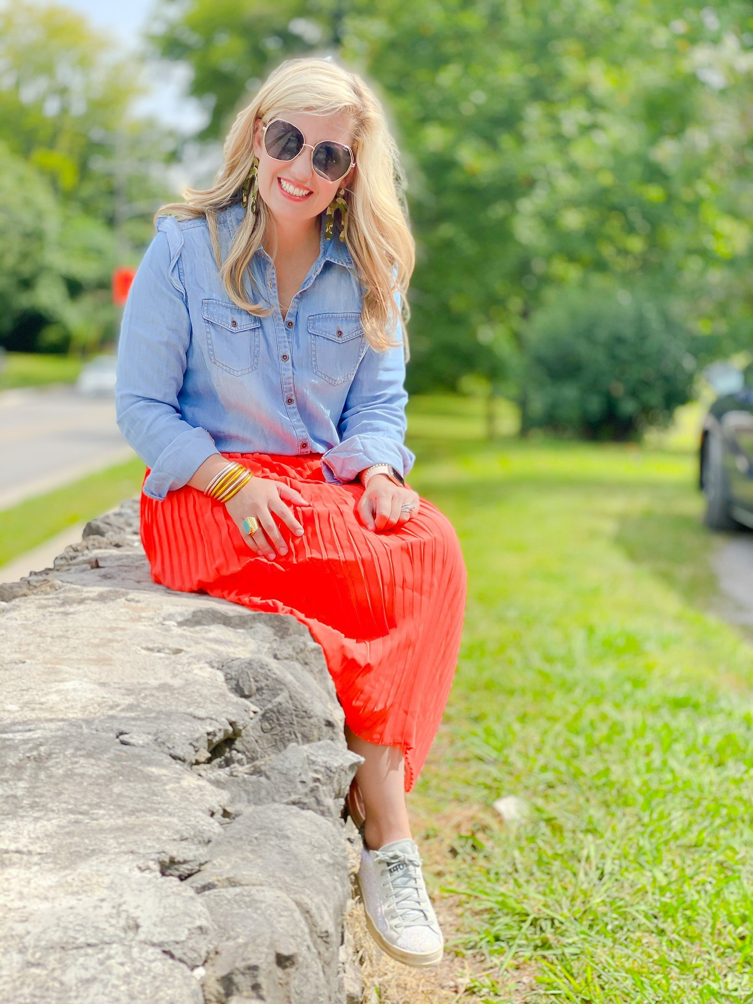 denim top with orange maxi and sneakers