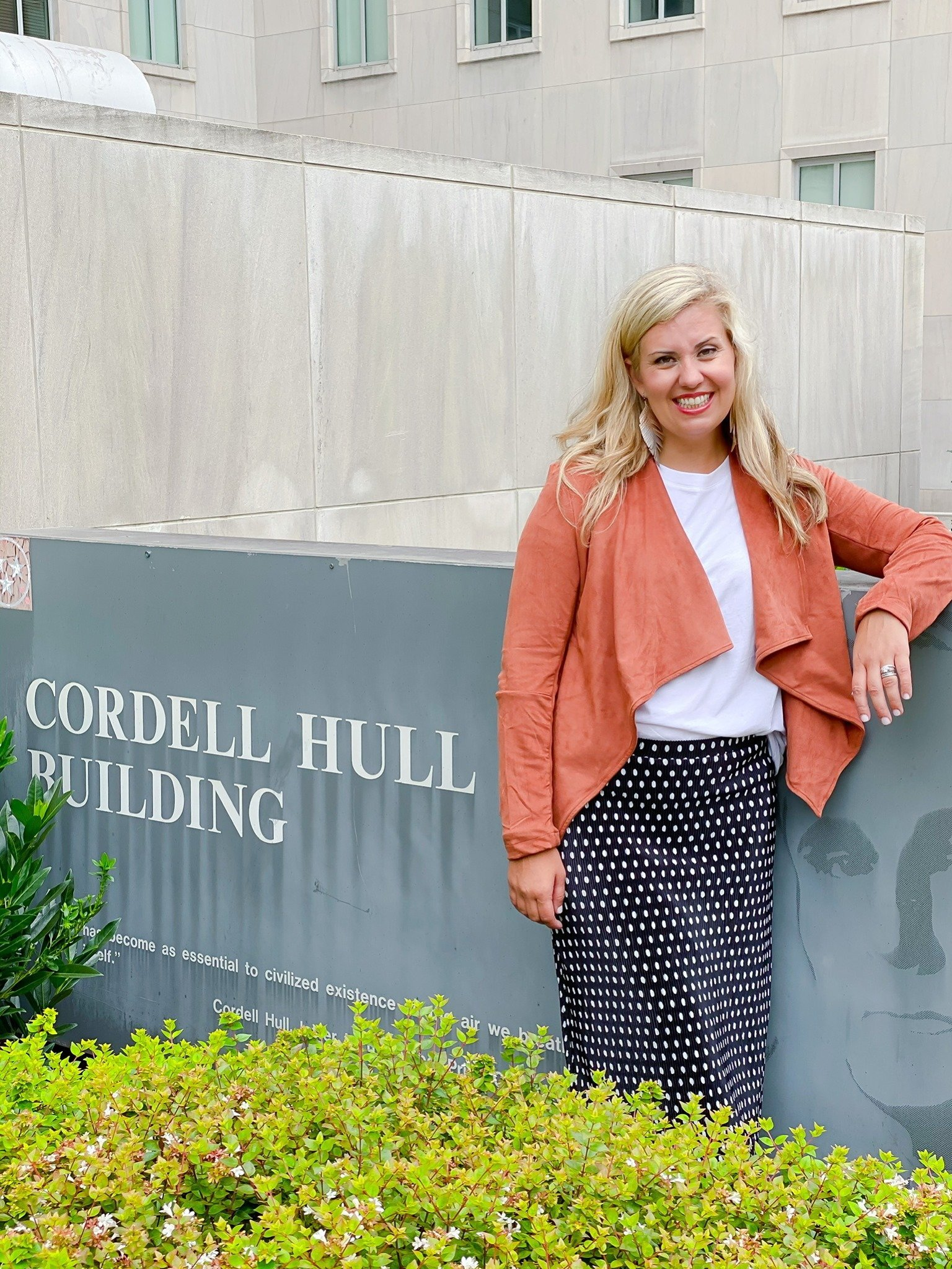 Wearing the Cordell Jacket by Good Hart next to the Cordell Hull Building in Nashville