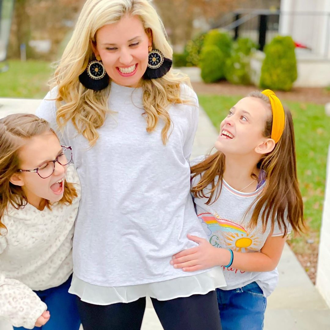 Catherine Martin with her two girls