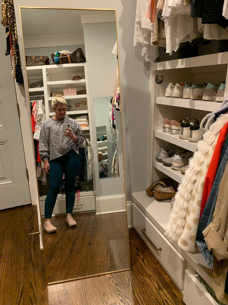 Catherine in her organized closet